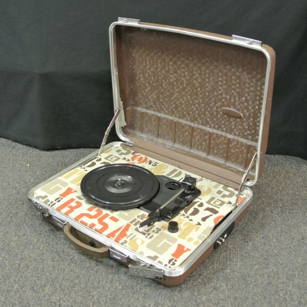 brown sit-n-spin suitcase turntable